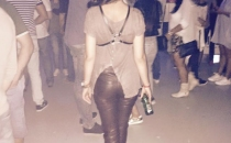 beige t-shirt & leather pants & boots & leather harness